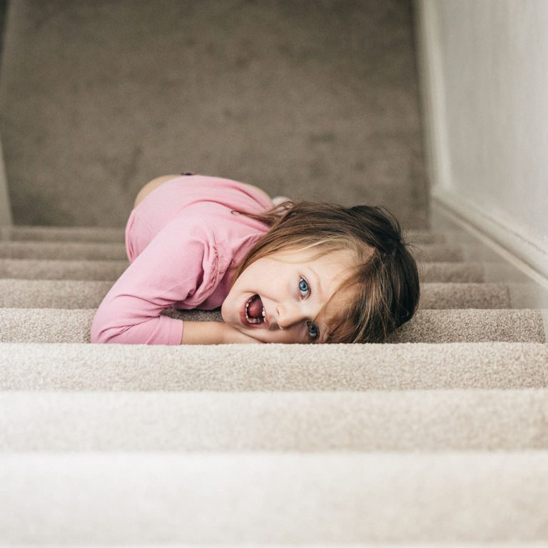 Family Photography_girl playing on stairs