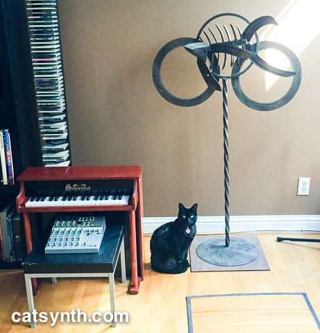 Luna with sculpture and toy piano