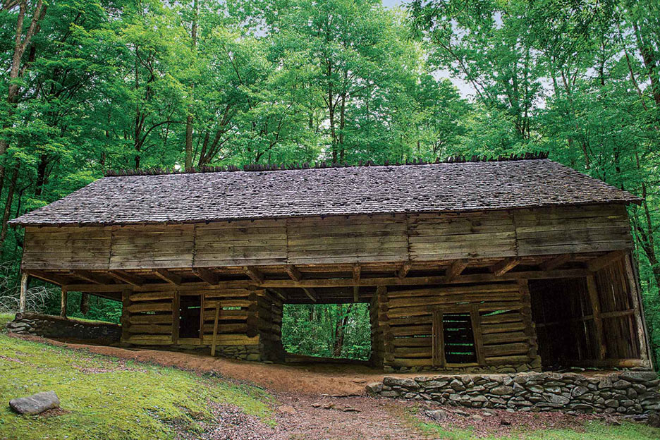 A cantilever barn built in 1875 stands near the Porters Creek Trail in the Great Smoky Mountains National Park.