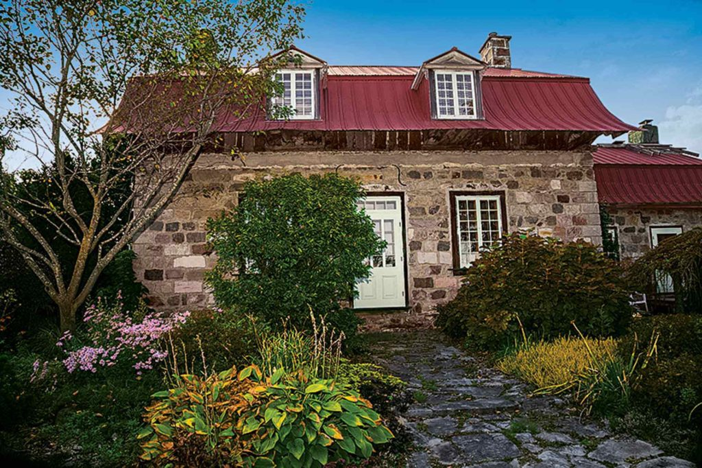 The old stone house was in ruins when the Archambaults first discovered it near L'Epiphanie, Quebec.