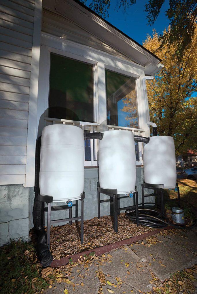 Many municipalities offer rebates to encourage installation of rain barrels like this bank of three 55-gallon tanks.