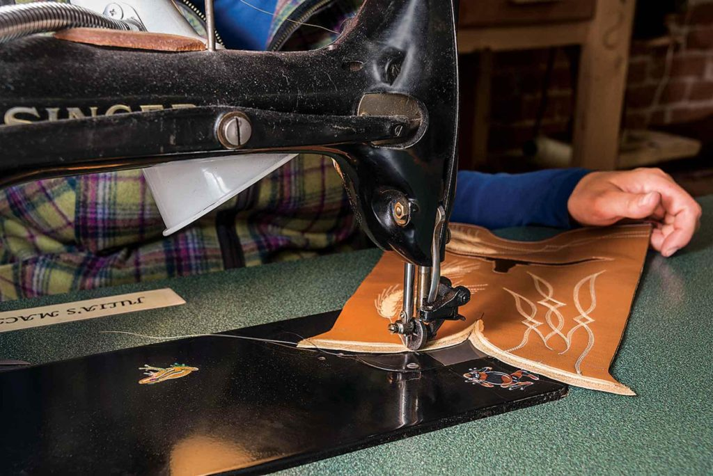 Julia sews a wheat design on a boot upper on her trusty sewing machine.