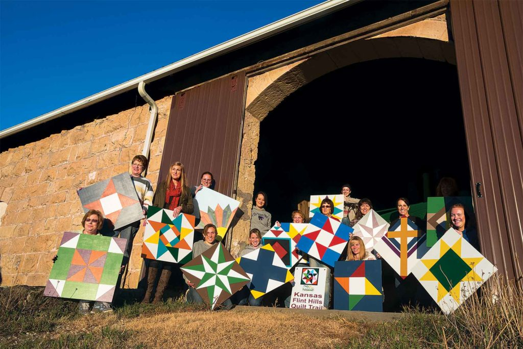 Students proudly display their creations after a barn quilt class in Chapman, Kansas, last fall.