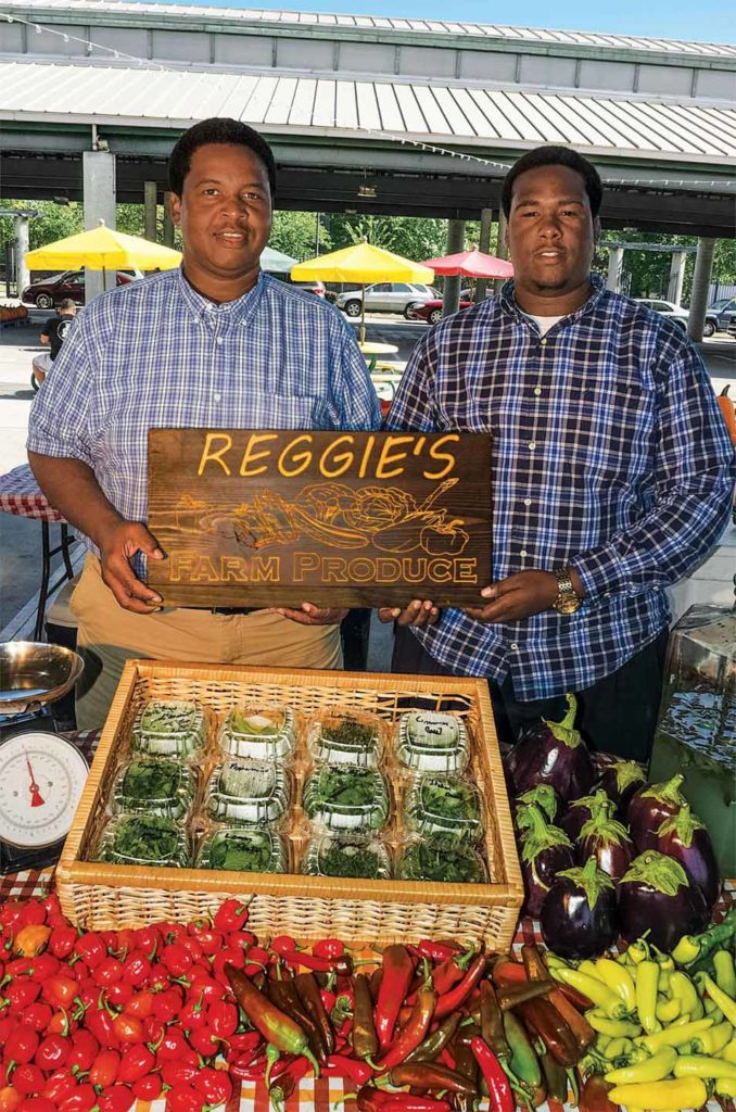 Reggie Marshall Sr. and Jr. both man the booth at the Nashville Farmers Market.