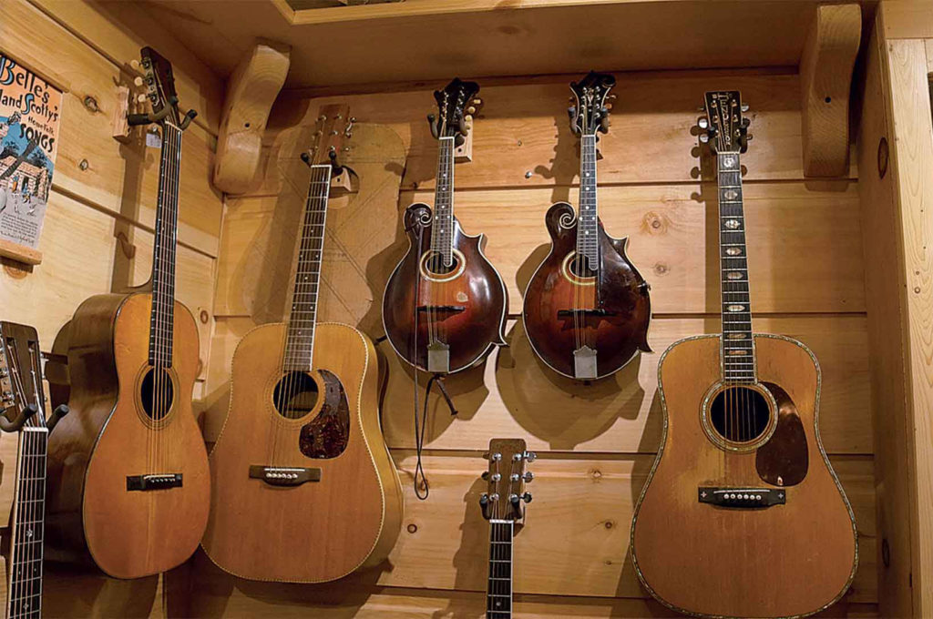 Fine guitars and mementoes hang on Henderson's wall.