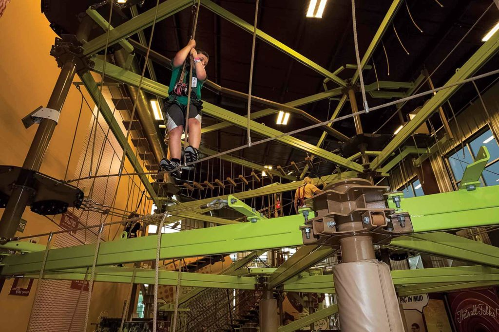 "A sky trail ropes course provides an aerial challenge for kids of all ages, and reveals pork ""factoids"" as climbers reach new heights."