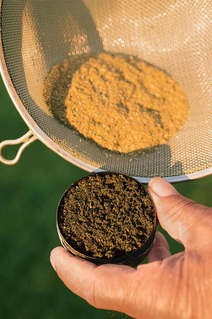 Alfalfa leaves are separated and ground before mixing.