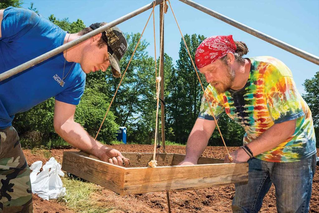 University of Memphis archeology students sift soil looking for pottery shards.