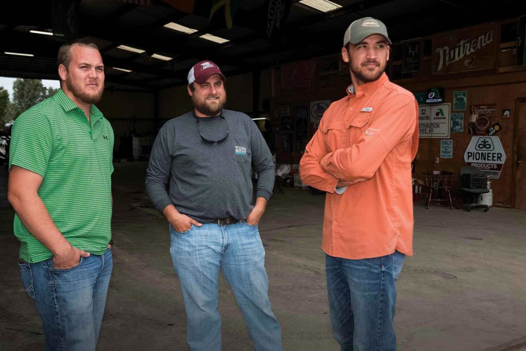 Young Arkansas farmers Layne Miles, Andrew Hartshorn and Steven French.