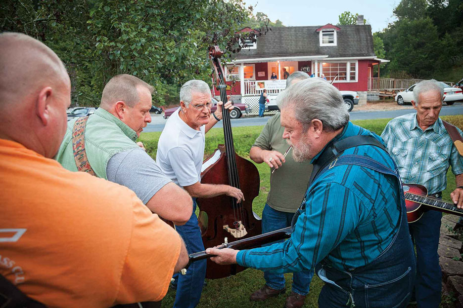 Bluegrass banjo player Millard Edwards leads a small group at a local jam.