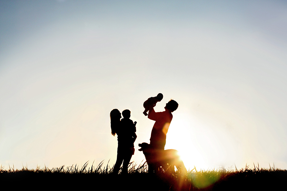 Adoptive Parents With Children And Dog