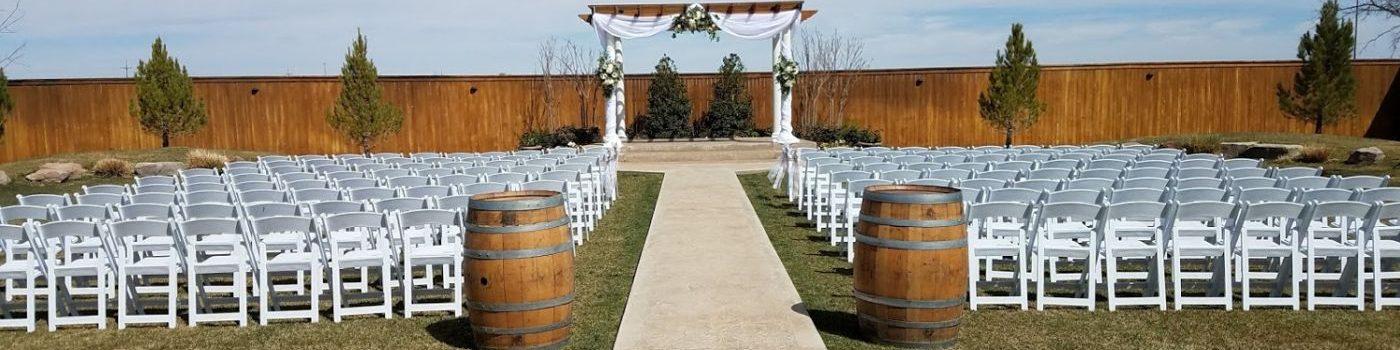 White Garden Chairs & Whiskey Barrels