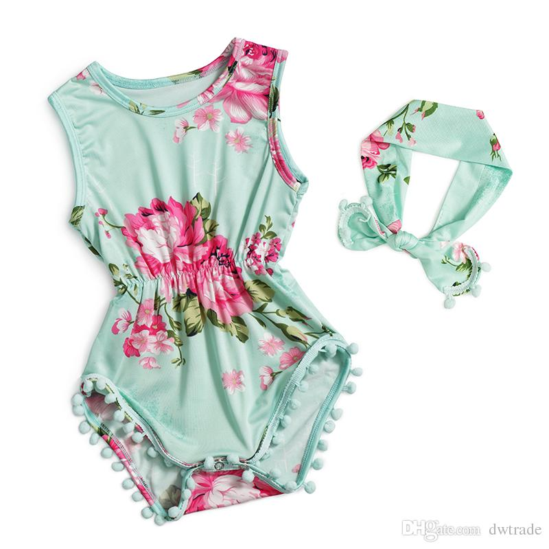 974683709347 The cut of this summer romper is appropriate since the fabric is a barrier  against the car seat straps. The accessories are also made of soft pom poms.
