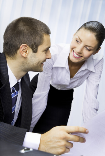 Signs a woman is interested in you at work