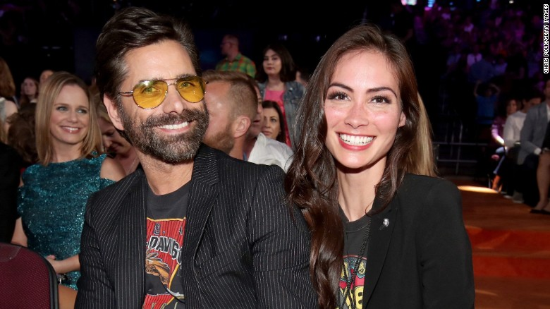 John Stamos engaged to model Caitlin McHugh at Disneyland