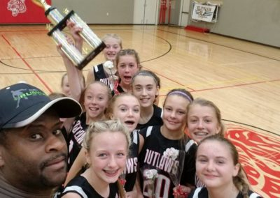 Girls' basketball team with Coach Eddie