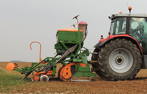 tractor with seeder attached to it