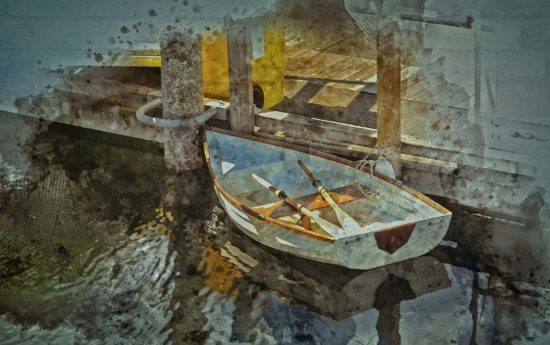 Another symbol of the past, this little rowboat lies waiting at the dock.
