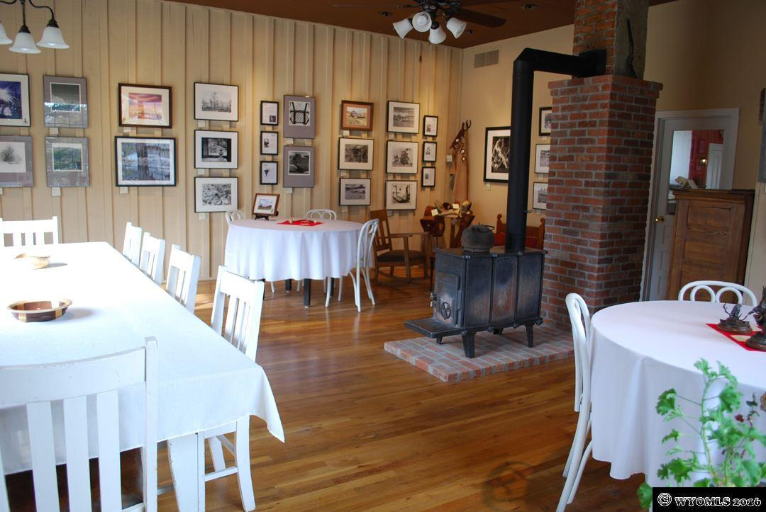 The huge dining room also houses an art gallery.