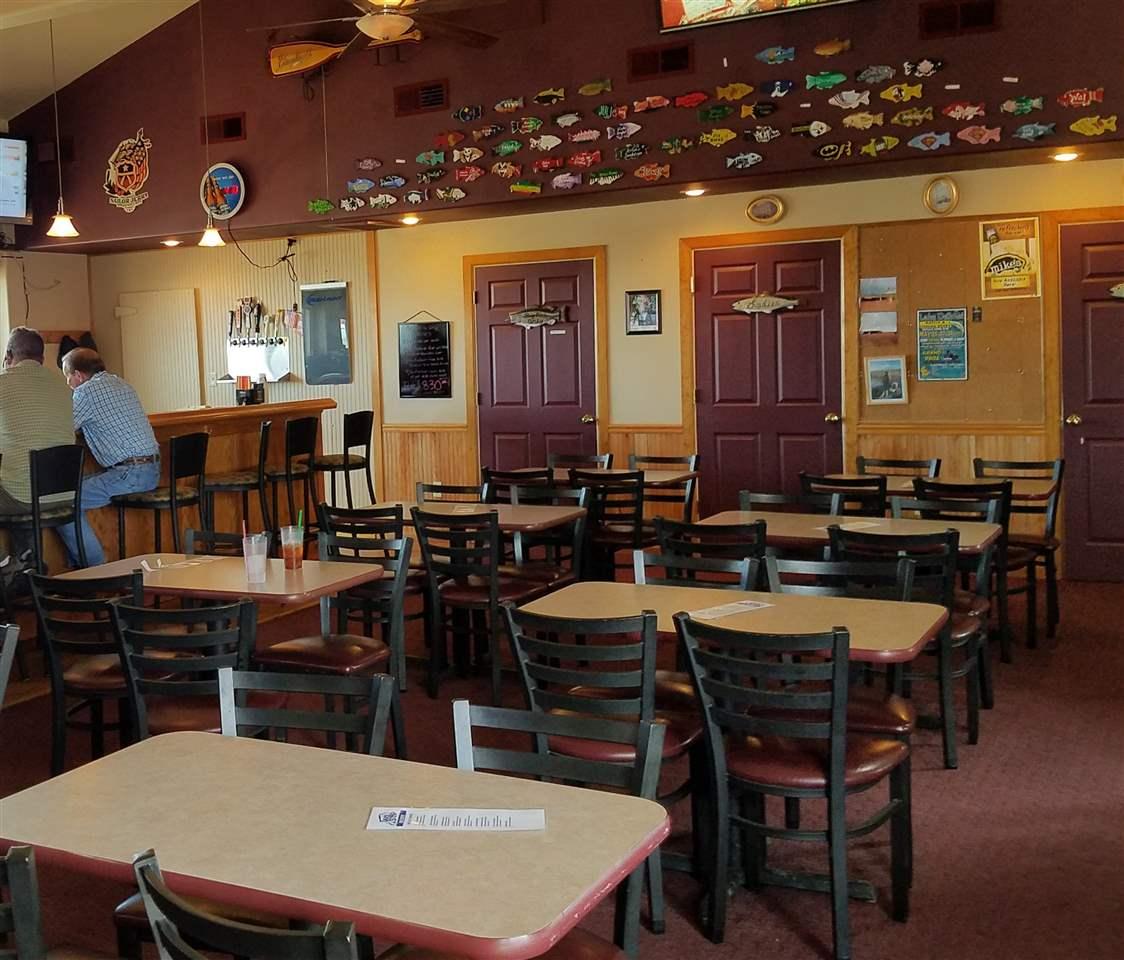 Resort Restaurant Seating, Restrooms, Bar and Door