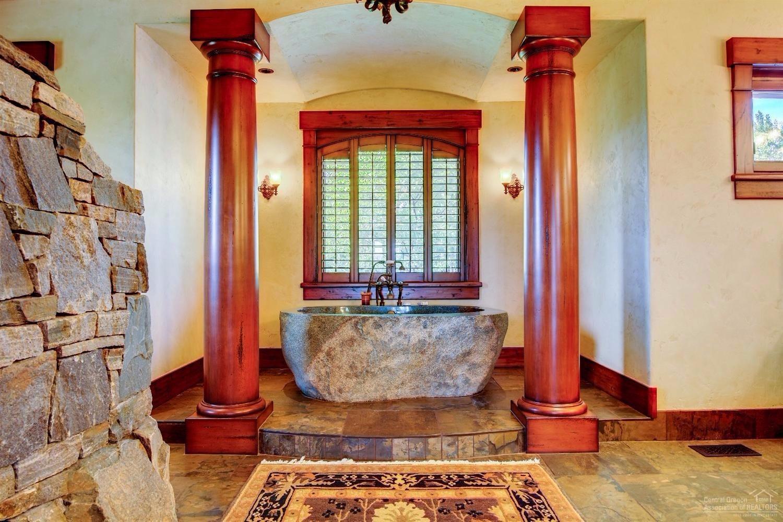 The granite soaking tub, wrap around walk in stack