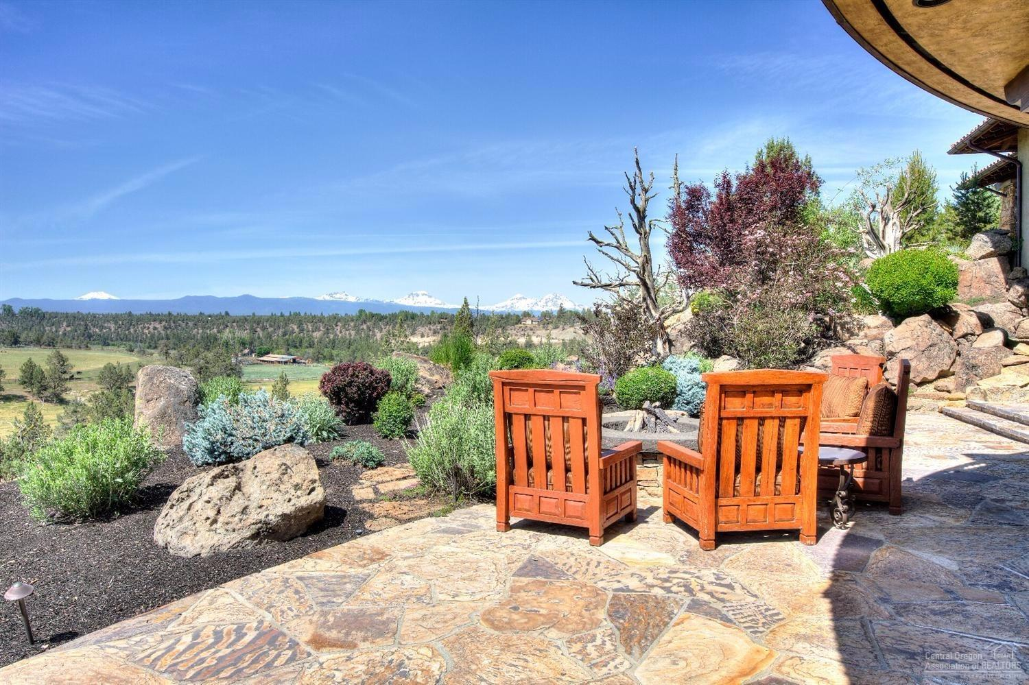 Outside, the flagstone patio with fire pit offers