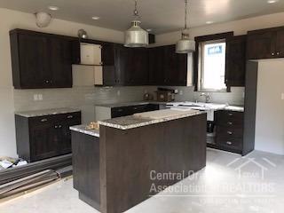 Kitchen of similar home at 754 S Wrangler - not co