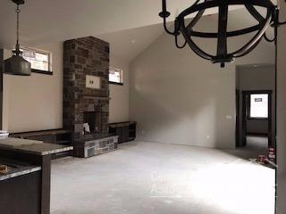 View of the gorgeous Montana stone fireplace and b