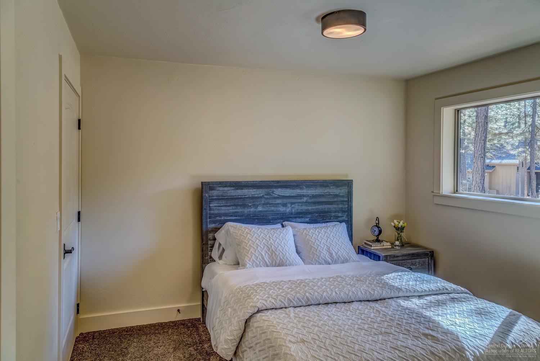 Main floor bedroom with walk in closet