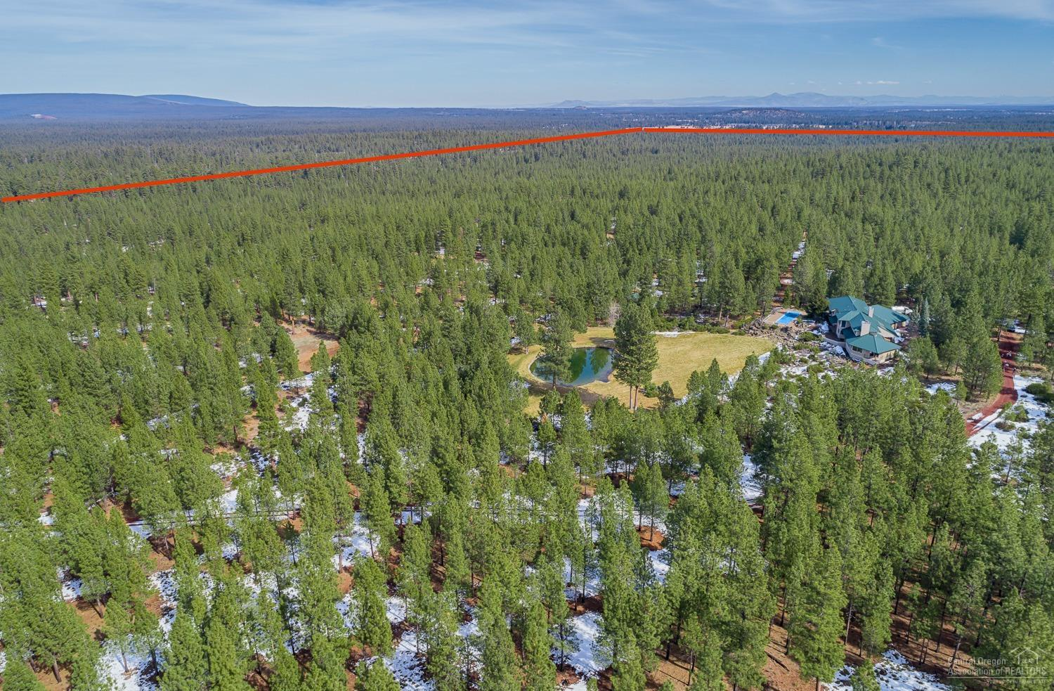 Another aerial property view with red line denotin