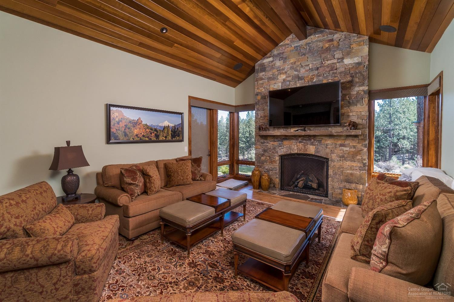 Family room with additional stone fireplace and pa