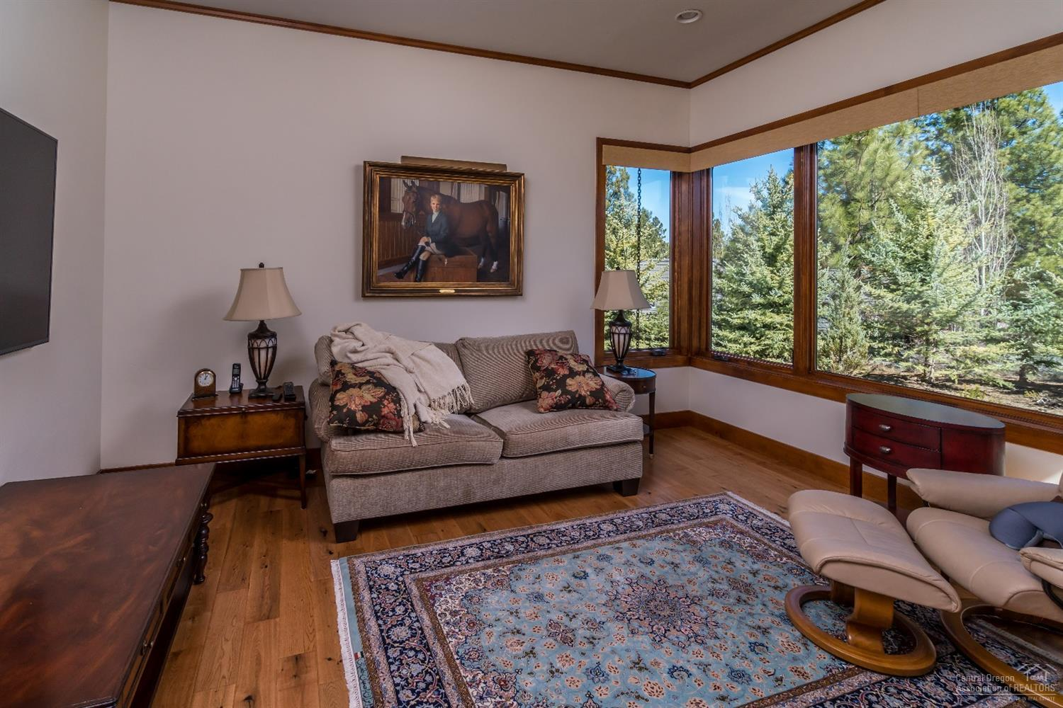Sitting area off master offers a secluded space fo