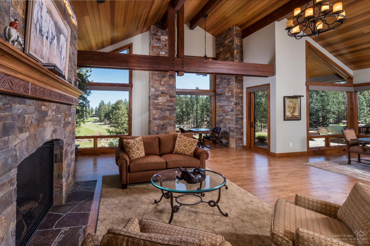 Vaulted great room greets guests. Large picture wi