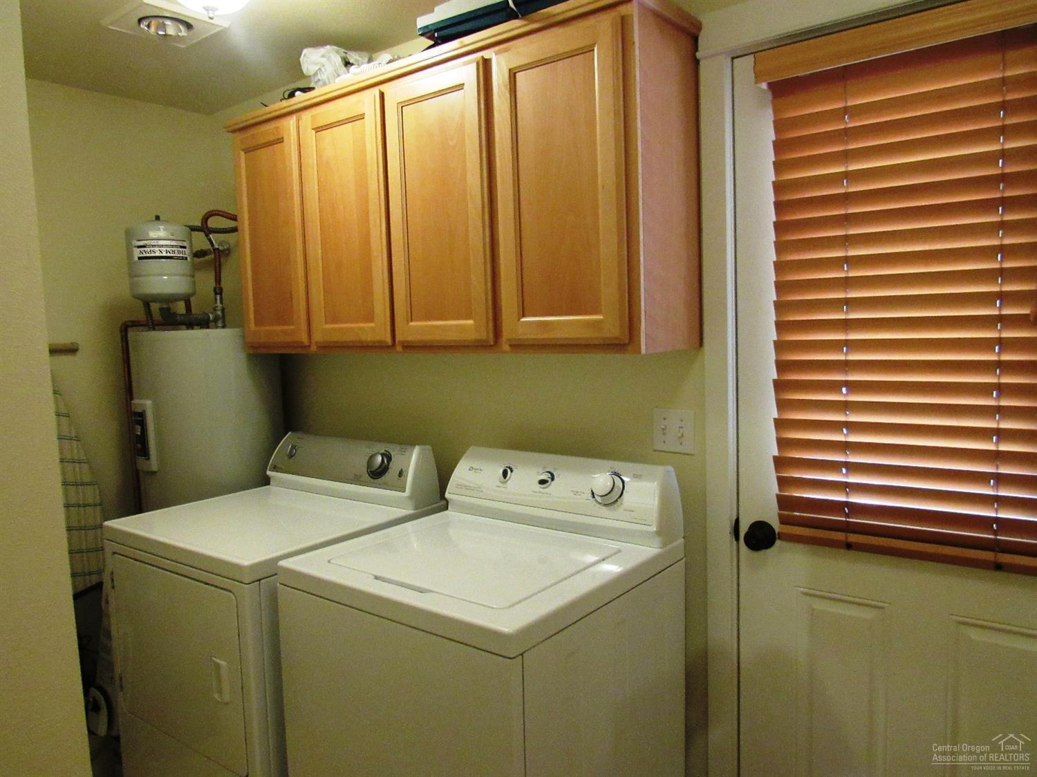 Separate utility area for washer/dryer with door t