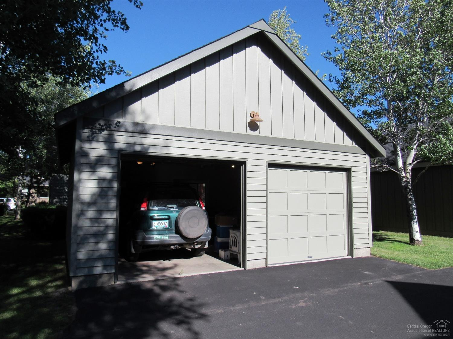2 car garage that has been sheetrocked.