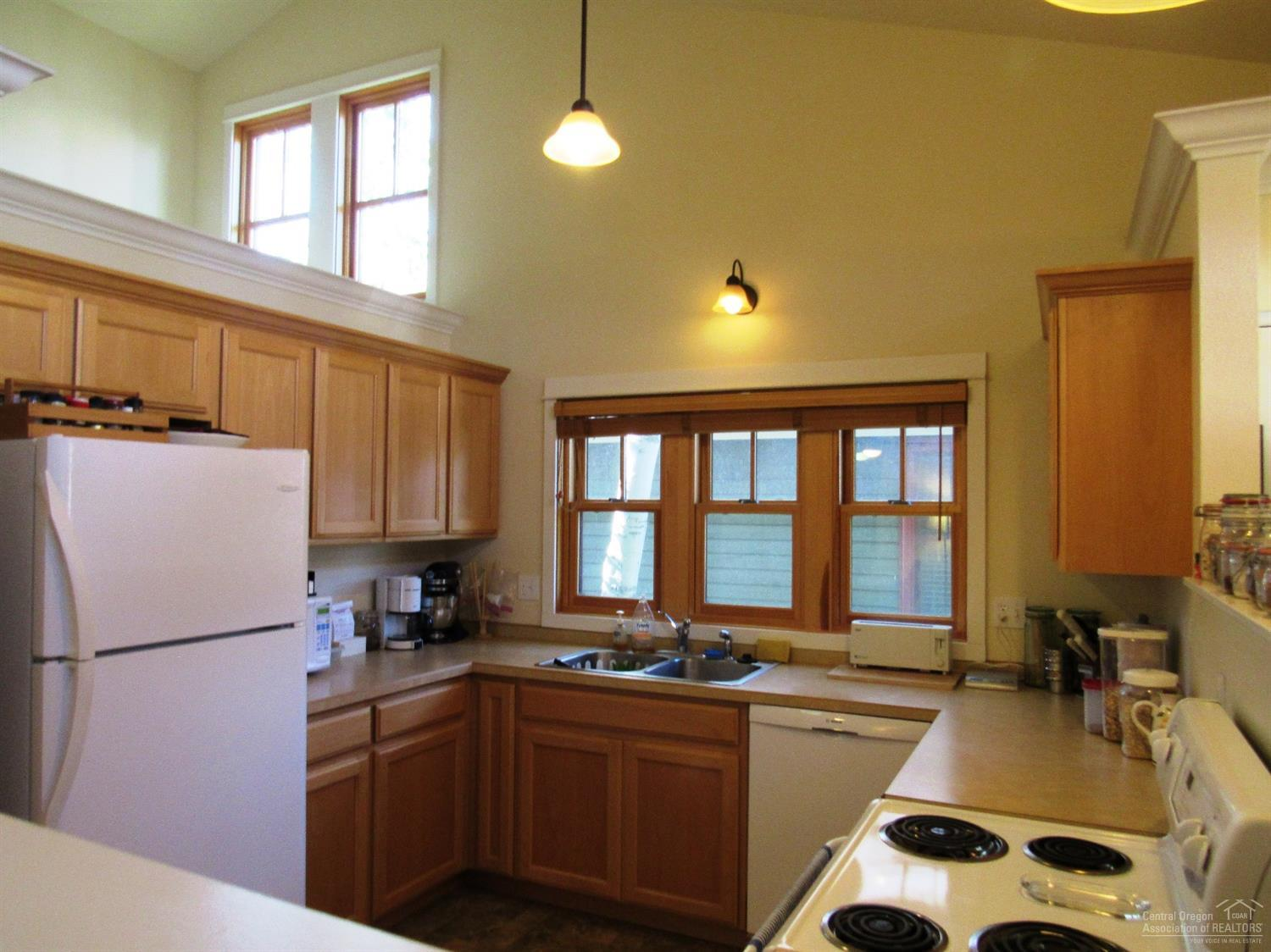 Kitchen with vaulted ceiling and accent ledge.