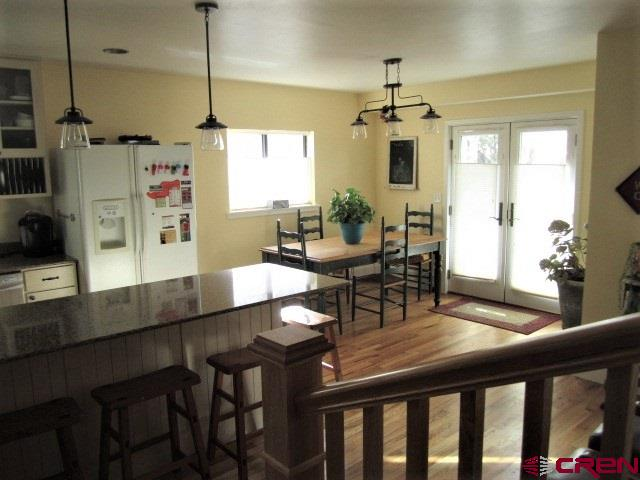 open dining area off of kitchen - doors are access