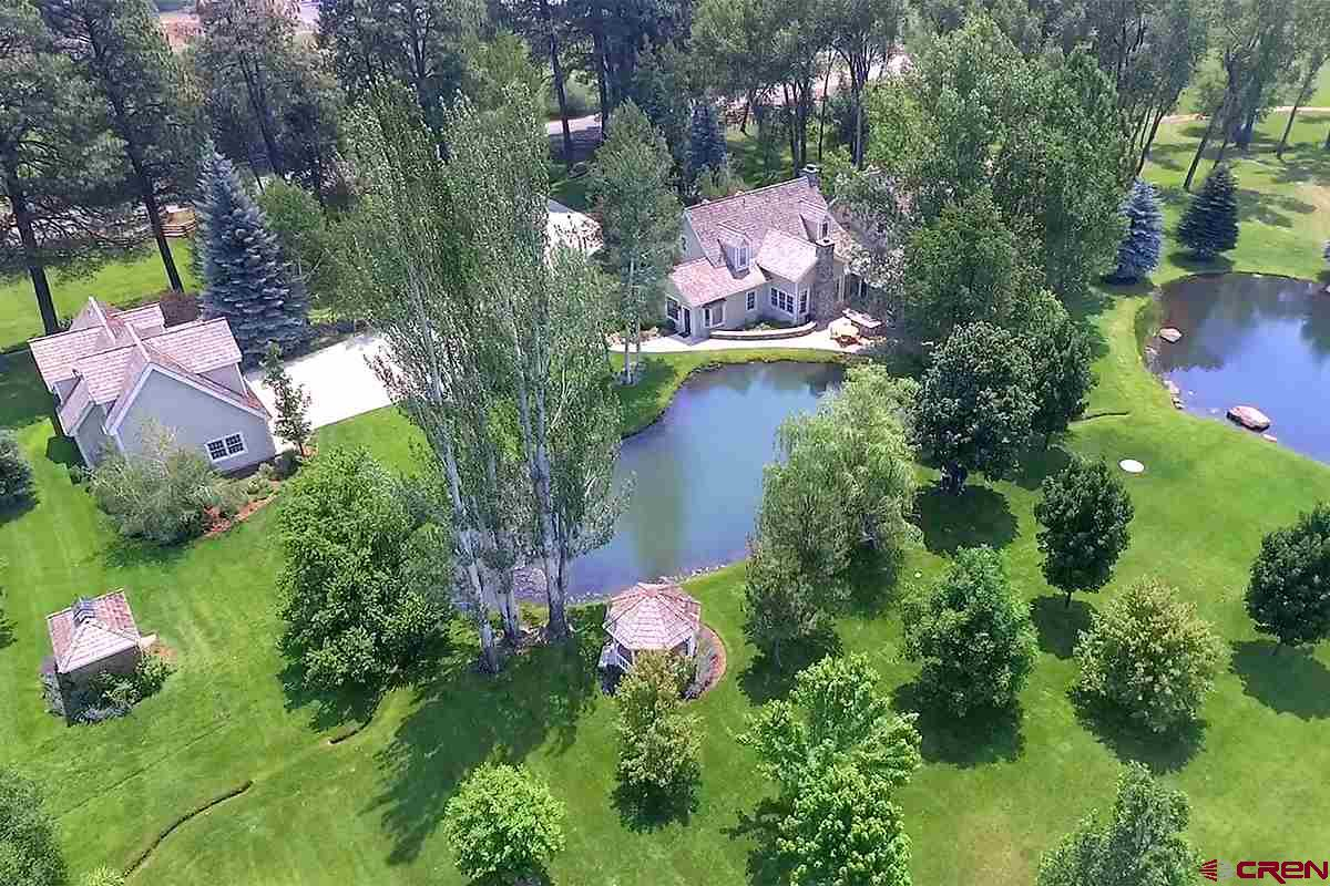 Aerial of guest house and pond