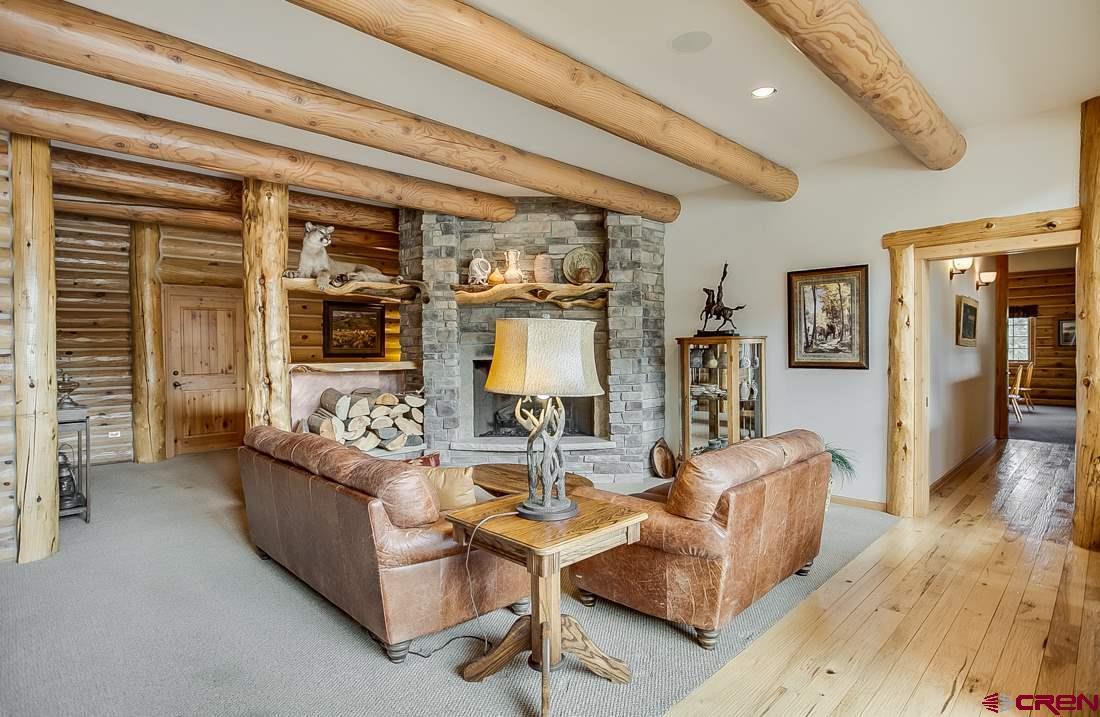 Medium size sitting area with fireplace.