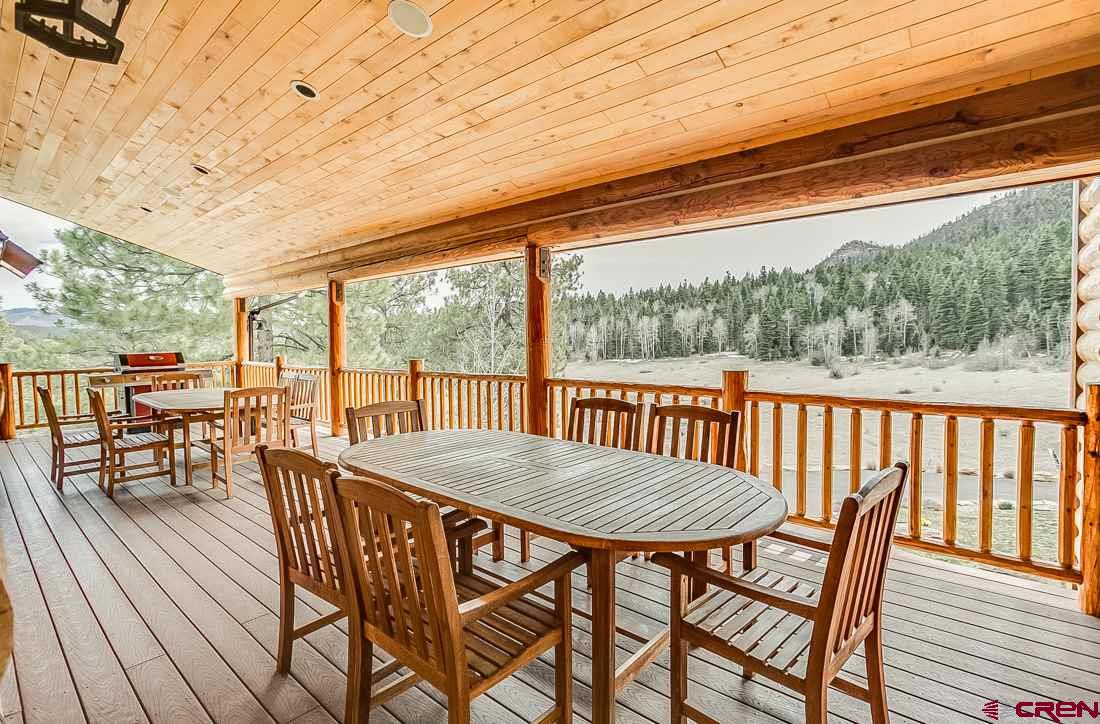 Deck off of dining area, seats additional 20 peopl
