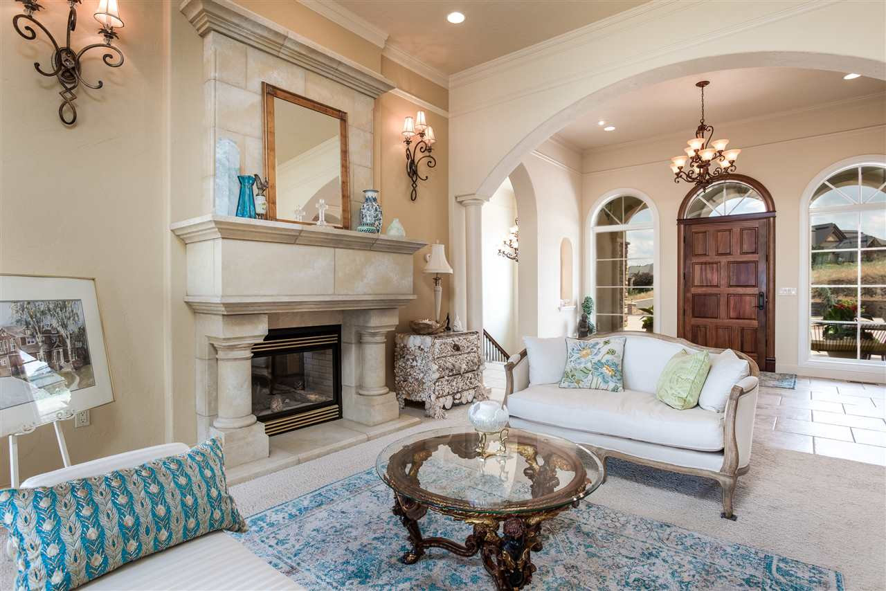 Strategically placed fireplace in parlor gives an