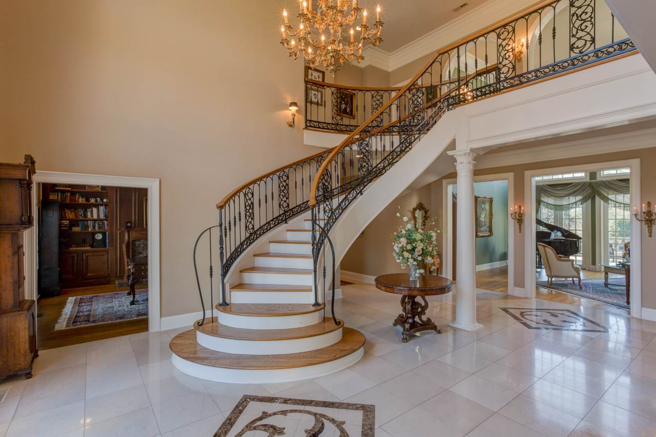 Step into this majestic foyer with the beautiful s