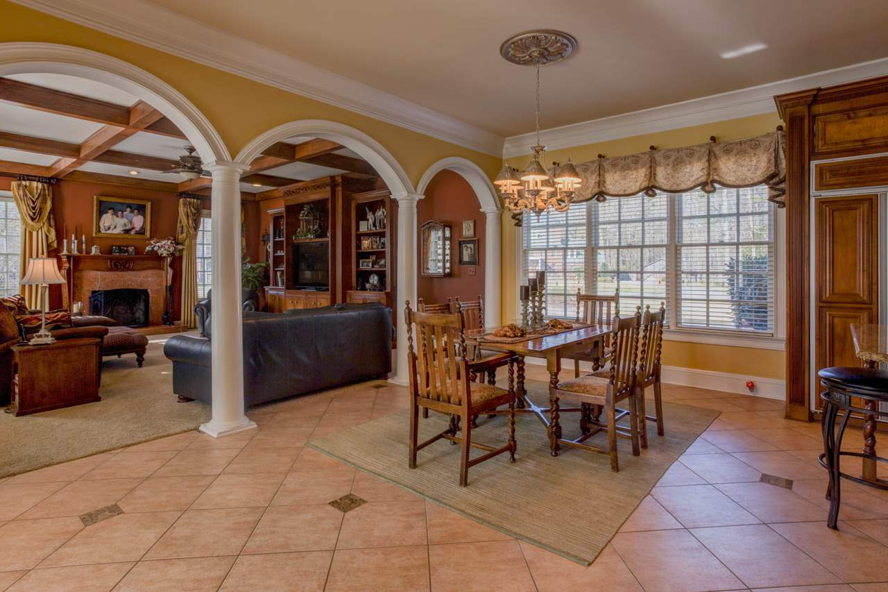 Open floor plan has breakfast room open to den.