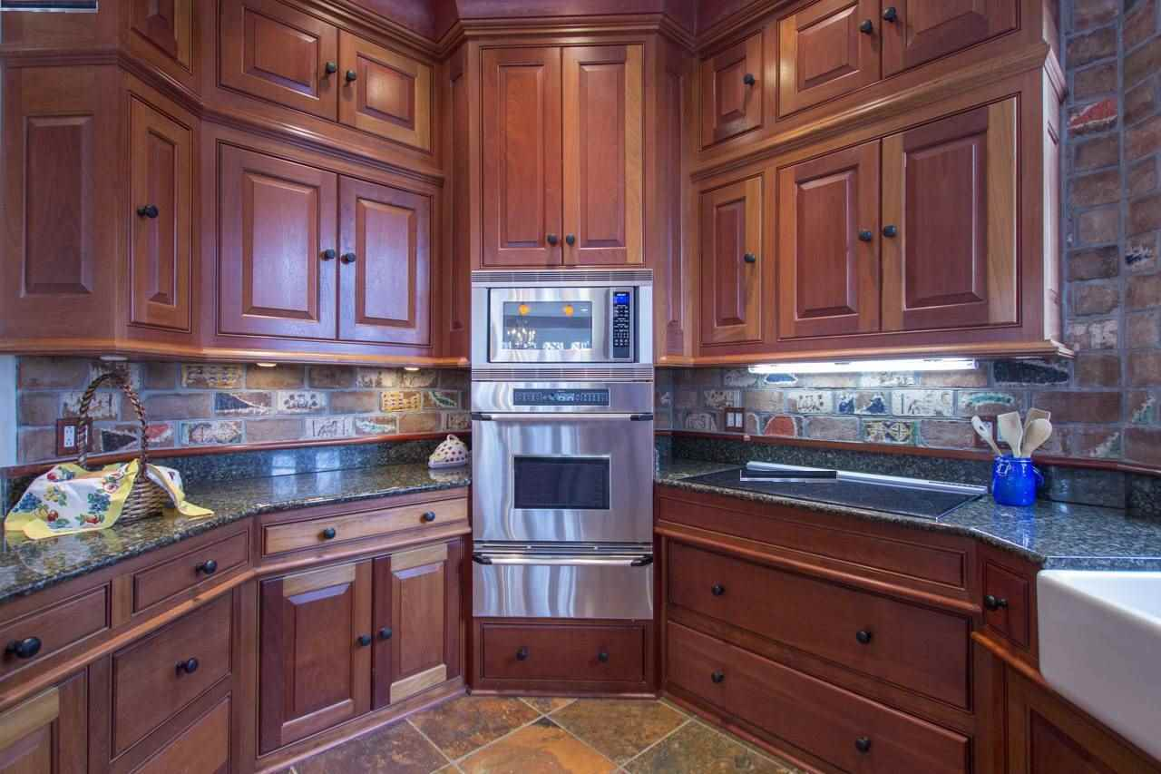 CHERRY CABINETRY AND BUILT-INS WARM IN THE KITCHEN