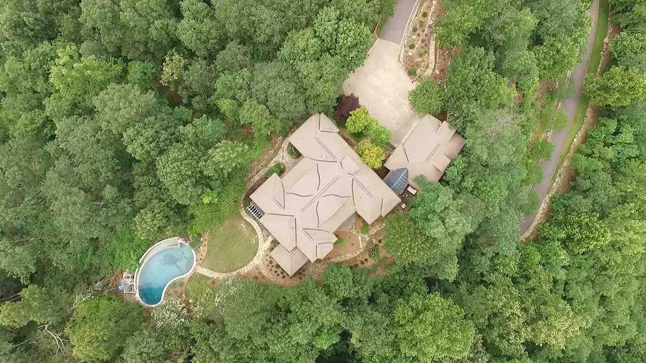 THIS ESTATE SITS ATOP 45 WOODED ACRES OVERLOOKING