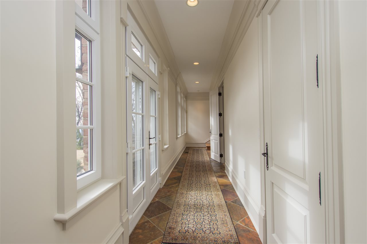 HEATED TILE FLOORING IN THE HALL LEADING FROM THE
