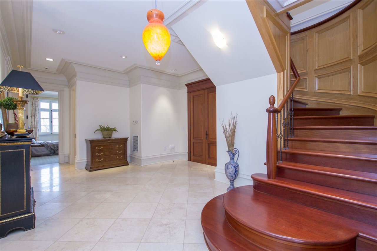 HEATED TRAVERTINE TILE IMPRESSES IN THE FOYER WHIL