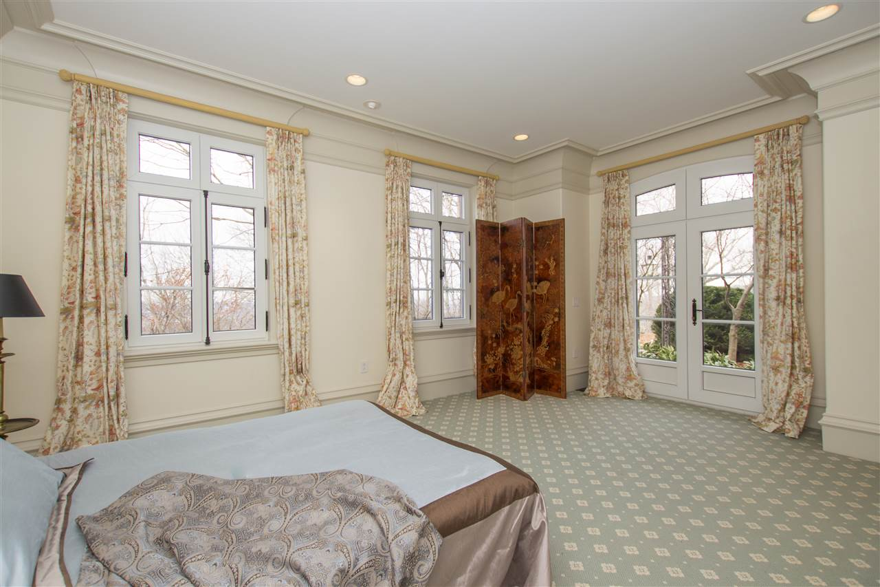 A MAIN LEVEL BEDROOM WITH BATH ACCOMODATES JUST OF
