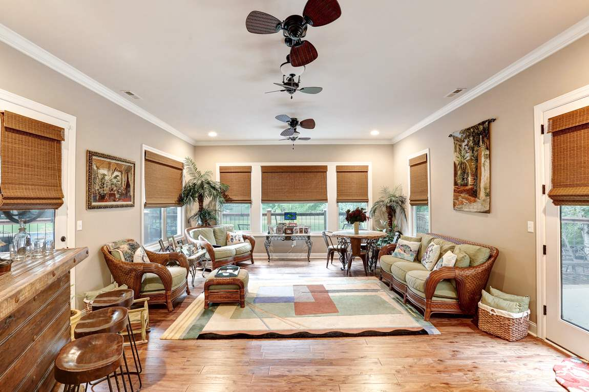 With hardwood flooring, dual ceiling fans, recesse