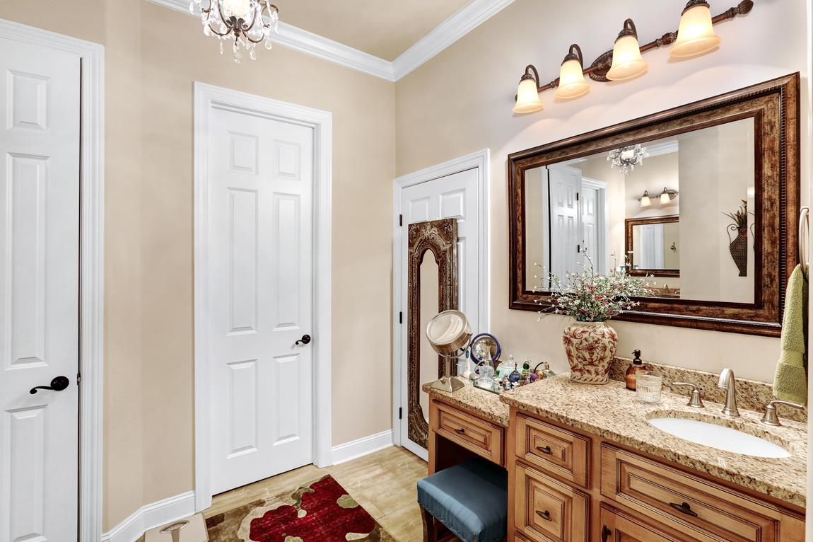 With tile flooring, dual vanities and make-up coun